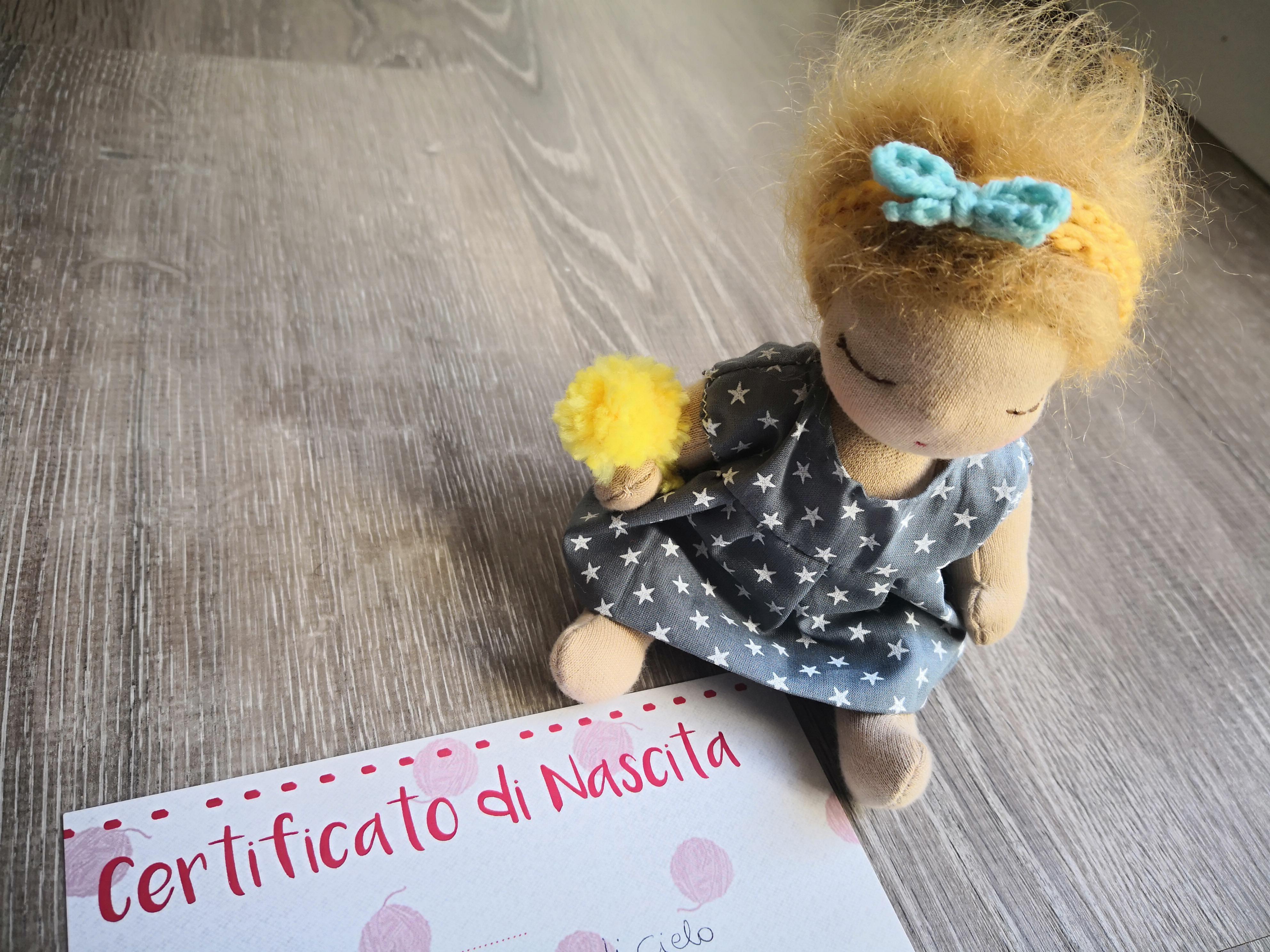 Un Certificato di Nascita per una Bambola?